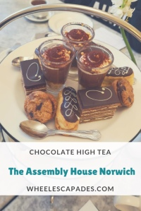 Title image of cake stand filled with chocolate desserts. The text 'Chocolate High Tea Assembly House Norwich'