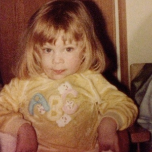 Me aged around 4 in a yellow ABC sweatshirt.