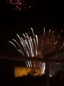 Norwich Castle at the bottom of the photo with fireworks soaring off it.