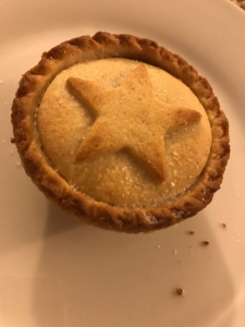 A photo of a mince pie with a pastry star on top