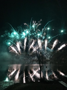 Stunning turquoise and white fireworks reflected in the lake.