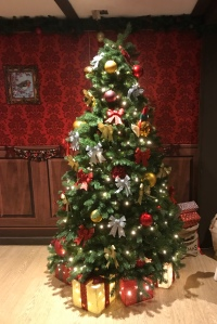 A decorated Christmas tree in Father Christmas's room.