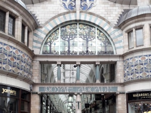 The grand entrance to Royal Arcade. This is a big open archway with curved glass work and an Art Nouveau style.
