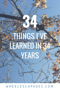An image to pin. The photo is looking up at pink blossom on trees. The title text 34 Things I've Learned In 34 Years is placed over.