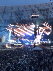 Another shot of Muse on stage. There is strobe lighting