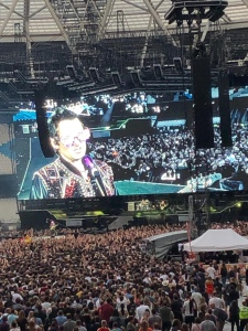 Photo close up of a screen showing Matt Bellamy's light up jacket and flashing glasses