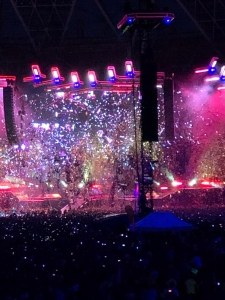 Confetti is showering the stage and audience.