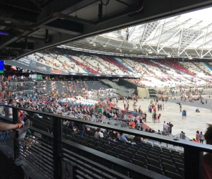A photo taken looking towards the left where you can see the curve of the stadium and seats filling up