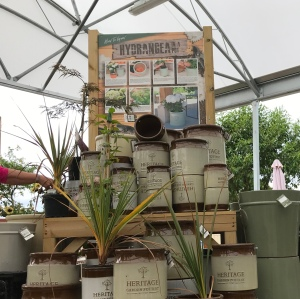 In the outside shop area there is still a roof for shelter. A stack of rustic pots for planting are on display