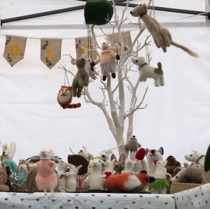A craft stall with miniature felted animals