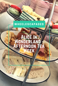 An image to pin. Close up of afternoon tea cake stand with title text Alice In Wonderland Afternoon Tea Week placed over.
