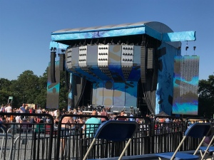 Looking closer at the stage by zooming in on my camera. The stage is blue with the Divide Tour logo