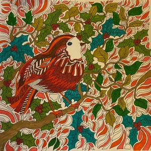 A page from a colouring book with a picture of a robin on a branch with holly and leaves around. It's coloured in reds, greens and oranges.