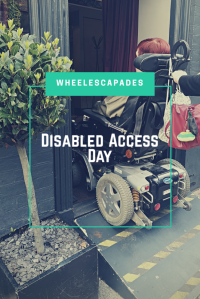 An image to pin. A photo of me in my wheelchair driving up a portable ramp into a restaurant. Title text, Disabled Access Day is placed over.