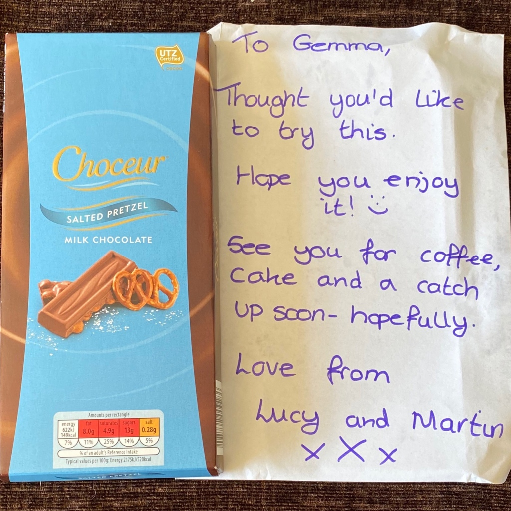 The salted pretzel chocolate bar with a note saying 'To Gemma, thought you'd like this to try. Hope you enjoy it. See you for coffee cake and a catch up soon hopefully. Love from Lucy and Martin xxx