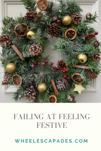 An image to pin. Failing at Feeling Festive title text is in grey on a cream background at the bottom. The top two thirds of the image is the photo of my wreath on the white door.
