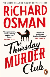 Thursday Murder Club book cover. Cream with bold red and black text. There is the silhouette of a black and red Fox in the centre.