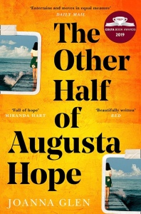 Book cover for The Other Half of Augusta Hope. The background is mottled orange and yellow. There is a Polaroid style photo sliced in half on either side of the cover. It's of a girl standing by the sea